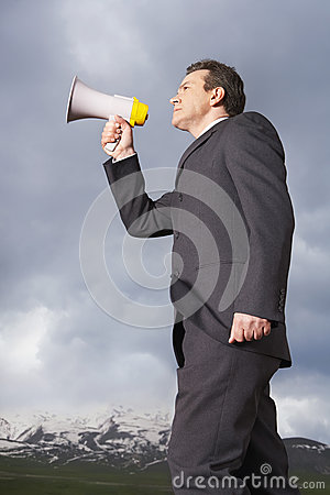 Businessman Speaking Through Megaphone