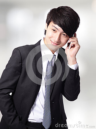 Businessman speaking smart phone