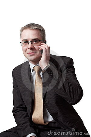 Businessman speaks by cell phone