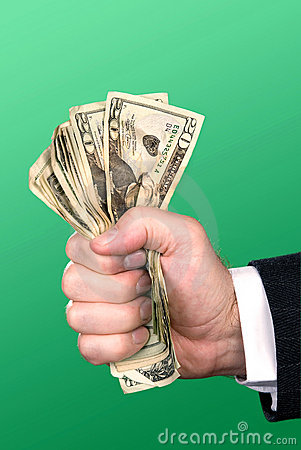 Businessman squeezing cash