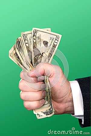 Businessman squeezing cash
