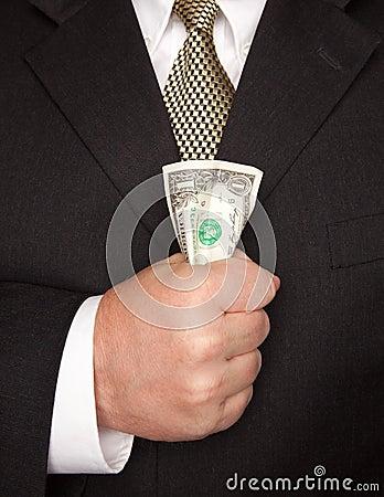 Businessman Squeezing Dollar Bill