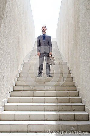 Businessman with stair - business concept