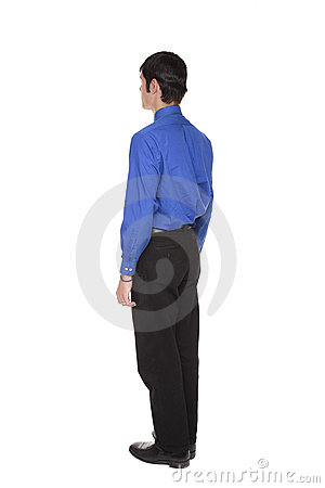 Businessman standing with arms at sides rear view