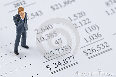 Businessman standing on the bottom line