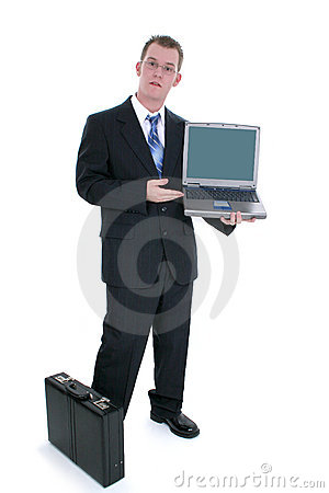 Businessman Standing With Briefcase And Open Laptop
