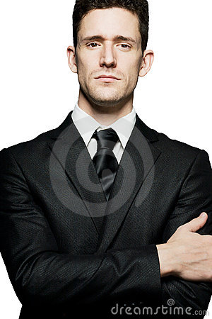 Businessman standing in confident pose. Isolated.