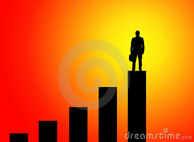 Businessman standing on graph peak