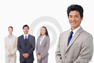 Businessman standing with his team behind him