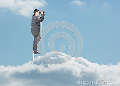 Businessman standing on ladder over the clouds