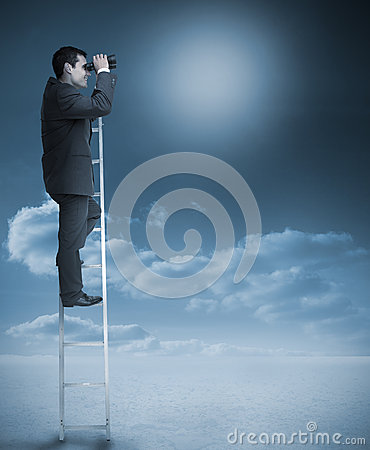 Businessman standing on ladder over clouds