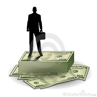 Businessman Standing on Money