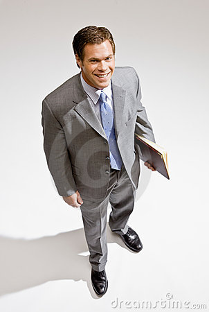 Businessman standing with notebook