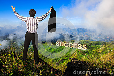 Businessman standing on a peak at mountain