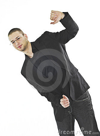 Businessman standing in strange, tilting position