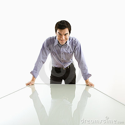Businessman standing at table