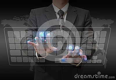 Businessman standing and working with touch screen