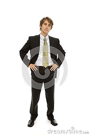 Businessman stands