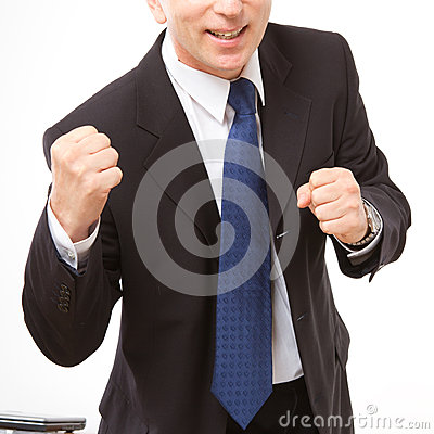 Businessman stands with clenched fists.