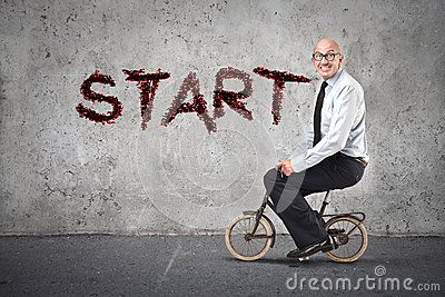 Businessman starting riding a bike