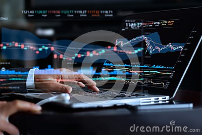 Businessman with statistic graph of stock market financial Stock Photo