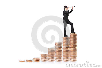 Businessman step on money and with telescope