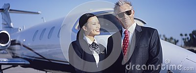 Businessman And Stewardess In Front Of An Aircraft