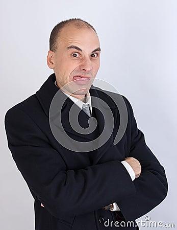 Businessman sticks his tongue