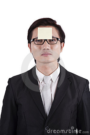 Businessman with sticky note on his head
