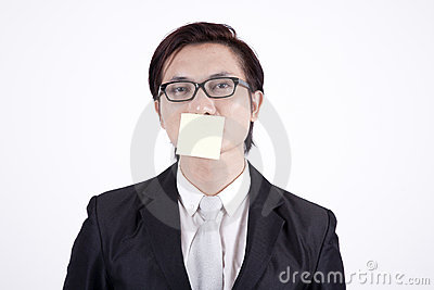 Businessman with sticky note on his mouth