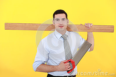 Businessman stood with saw
