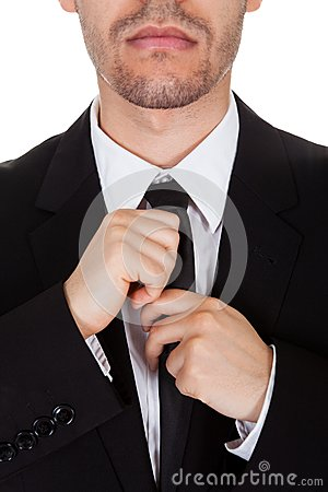 Businessman straightening his tie