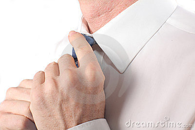 Businessman straightens his tie