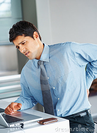 Businessman suffering from lower back pain