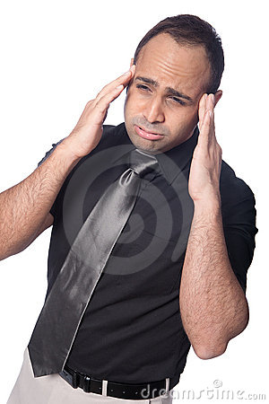 businessman suffers stress headache.