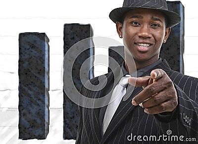 Businessman In Suit Against Bar Graph
