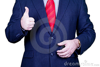 Businessman in suit red tie holding thumbs up