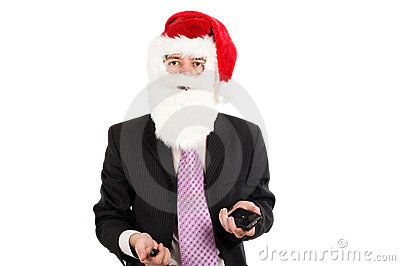 Businessman in suit with santa hat on head.