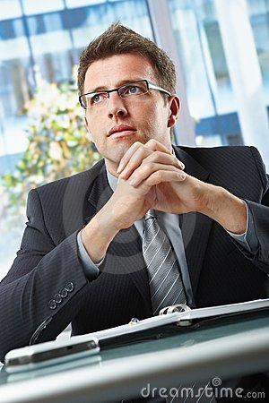 Businessman in suit sitting in office