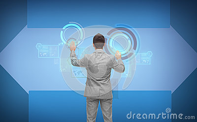 Businessman in suit working with virtual screens Stock Photo