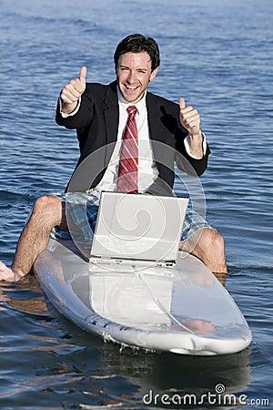 Businessman on Surfboard