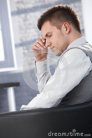 Businessman taking a break in armchair