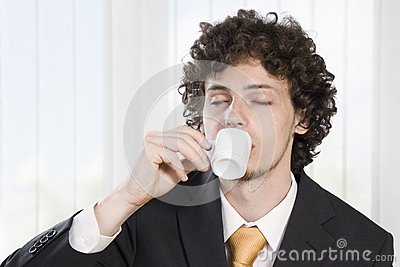 Businessman taking a break with a cup of coffee