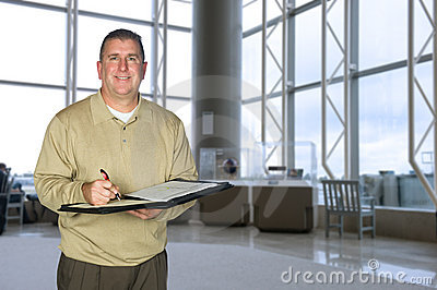 Businessman taking notes in lobby