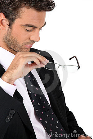 Free Businessman Taking Off His Glasses Stock Photography - 21257602