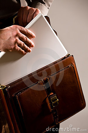 Businessman Taking Uot Laptop From Case Royalty Free Stock Image - Image: 4188196