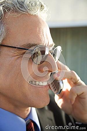 Businessman talking on cellphone.