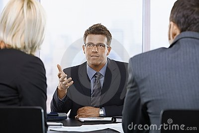 Businessman talking at meeting