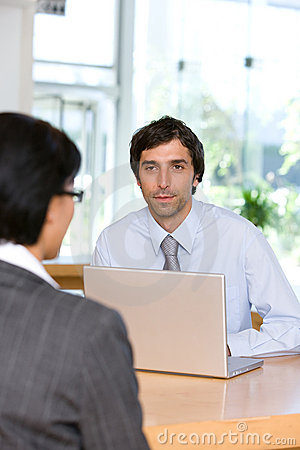 Businessman talking to client