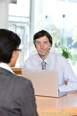 Businessman talking to client
